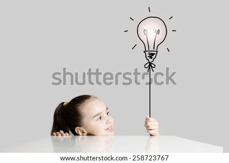 Little cute school girl and electric bulb - stock photo