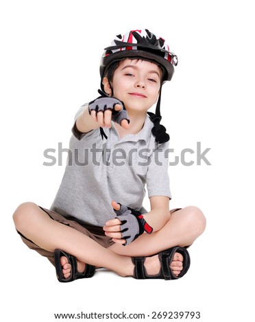 little cycling sitting on the floor pointing into the camera - stock photo