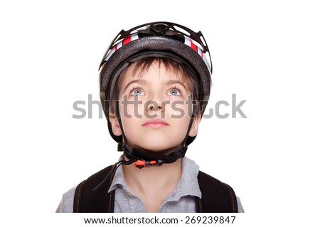 little cyclist in helmet looking up closeup portrait - stock photo