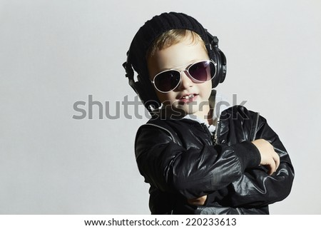 little deejay. funny smiling boy in sunglasses and headphones.5 years old child listening music in headphones. DJ kids - stock photo