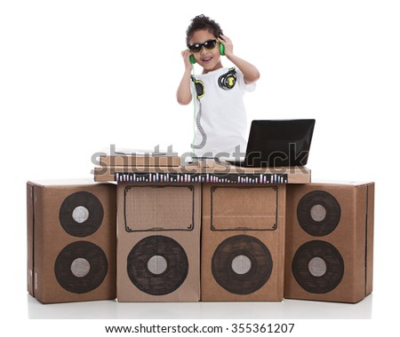 Little DJ.  Adorable mixed race boy pretending to be a DJ.  Isolated on white. - stock photo