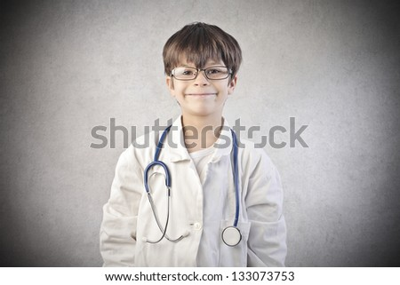 little doctor with glasses and white coat - stock photo