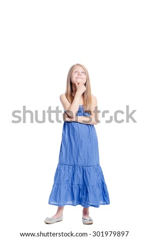 Little dreamer. Full length of thoughtful pretty little girl looking up. Isolated on white. - stock photo
