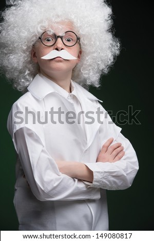 Little Einstein. Confident little boy looking like Einstein and standing isolated on black - stock photo