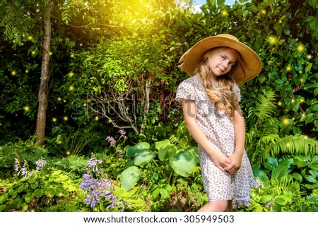 Little elegant girl resting in a beautiful summer park. Happy childhood. Kids fashion. Holidays.  - stock photo