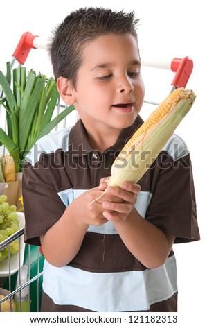 Little enjoying corn on the cob - stock photo