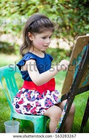 Little European girl painting - stock photo