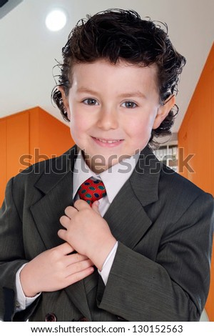 Little executive with elegant clothes in the office - stock photo