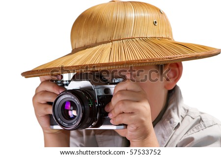little explorer taking pictures with his analog SLR film camera - stock photo