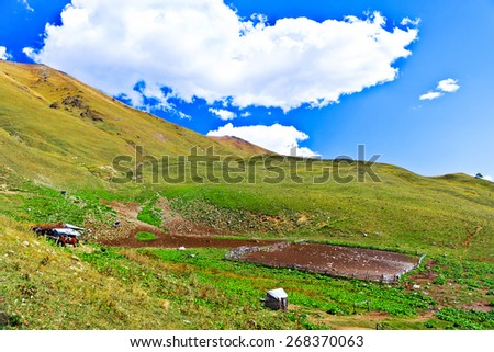 Little farm in the Caucasus mountains. Picture was taken during a trekking hike in the northern Caucasia mountains at autumn, Arhiz region, Russia - stock photo