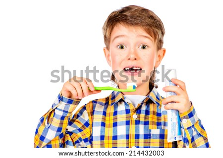 Little funny boy smiling and brushing his teeth. Healthcare. Isolated over white. - stock photo