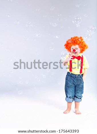 Little funny clown - stock photo