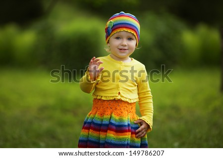 little funny girl greets hands up - stock photo