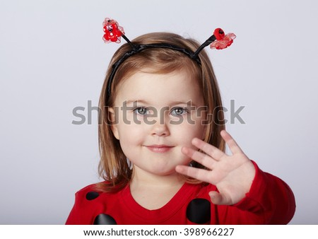 little funny girl in ladybug costume - stock photo