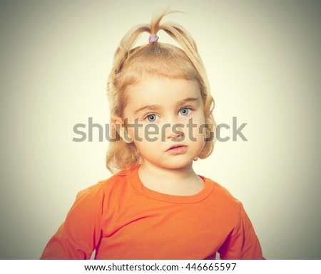 Little Funny girl in orange blouse. Isolated on white background - stock photo