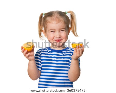 Little Funny girl in striped shirt  keeps lemons. Isolated on white background - stock photo