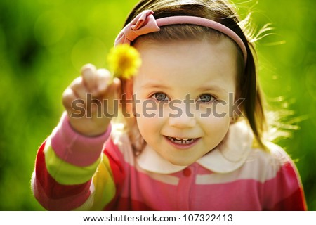 little funny girl with dandelion - stock photo