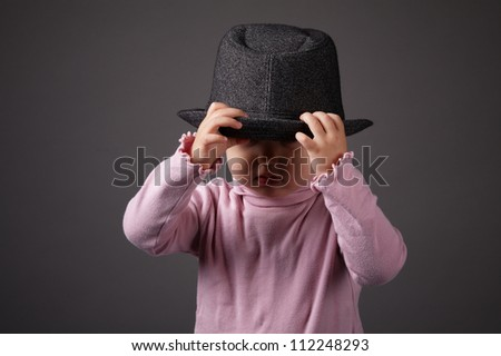 little funny girl with hat - stock photo