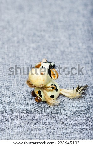 Little funny toy cow - stock photo