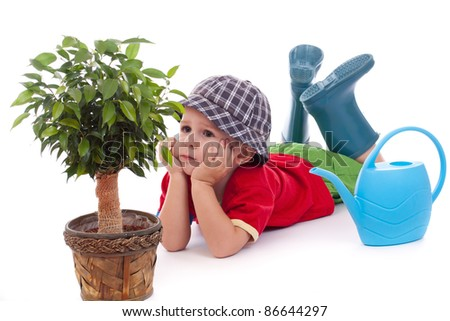 Little gardener boy, isolated on white - stock photo