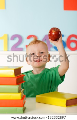 little genius with books for reading - stock photo
