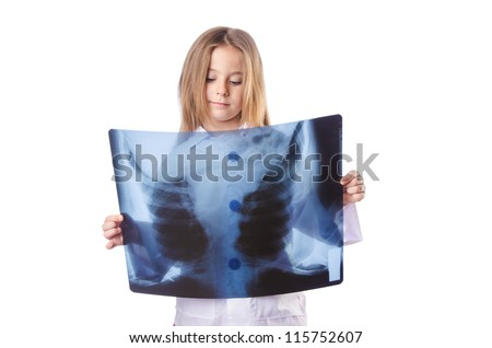 Little gilr playing doctor with x-ray - stock photo
