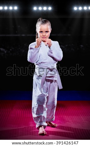 Little girl aikido fighter at sports hall - stock photo