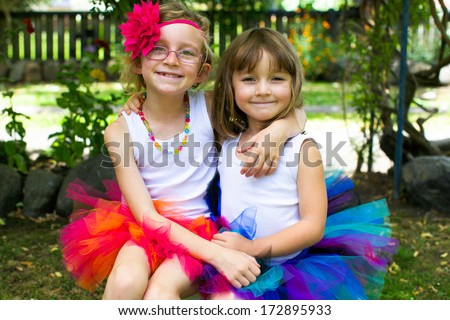 Little girl all dressed up in a colorful tutu. - stock photo