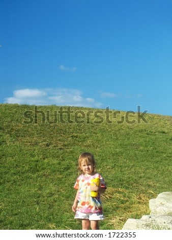 Little Girl and Blue Sky - stock photo