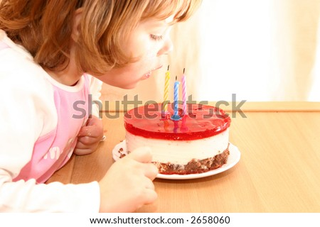 little girl and her birthday cake with candles - stock photo