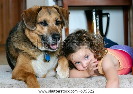 Little girl and her dog at the top of the stairs - stock photo