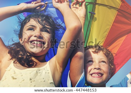 Little Girl And Little Boy Playing Kite Together Concept - stock photo