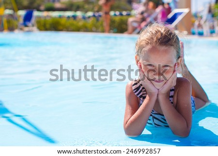 Little girl at aquapark during summer vacation - stock photo