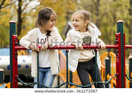 Little girl at playground - stock photo