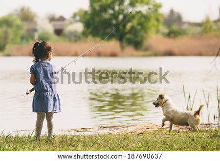 Little girl at the fishing - stock photo