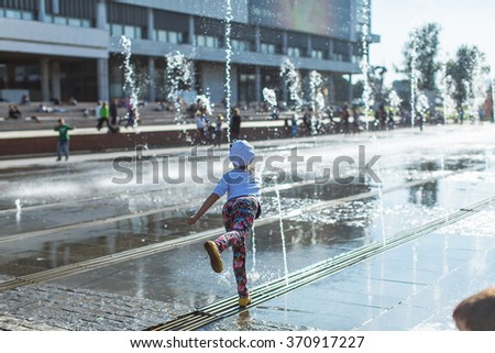Little girl at the fountain in Moscow - stock photo