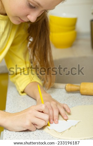 little girl at the kitchen  - stock photo