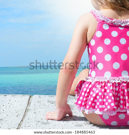 Little girl at the sea - stock photo