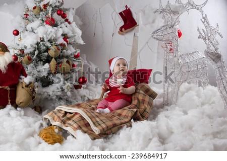 Little girl, baby in Christmas interior - stock photo