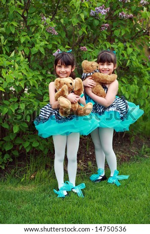 little girl ballerinas in costumes with teddy bears - stock photo