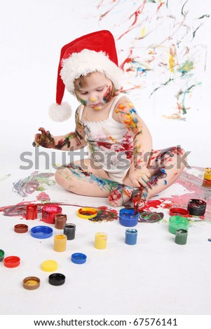 little girl bedaubed with bright colors - stock photo
