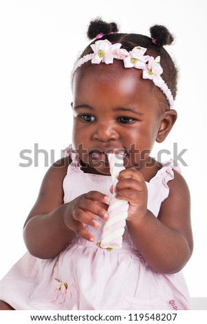 Little girl being photographed in the studio. - stock photo