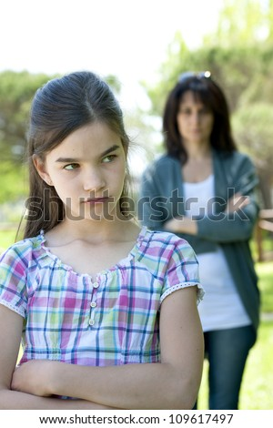 Little girl being told off by her mother - stock photo