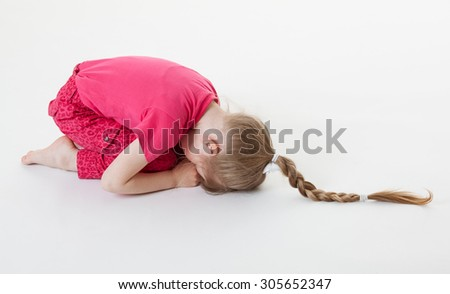 Little girl bending and closing her eyes in the squatting position, white background - stock photo