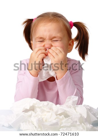 Little girl blows her nose, isolated over white - stock photo