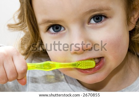 Little girl brushes her teeth - stock photo