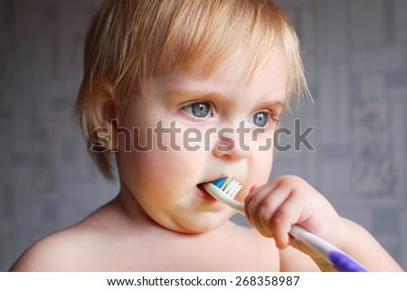 Little girl brushing her teeth  - stock photo