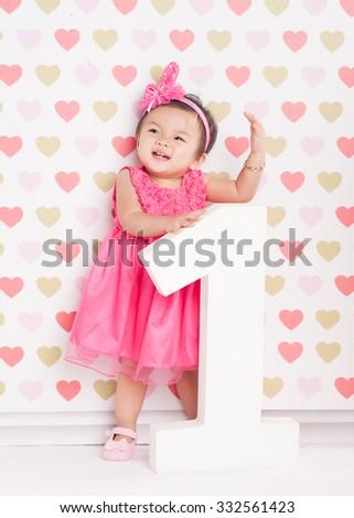 Little girl celebrating first birthday - stock photo