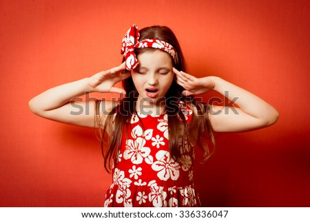 Little girl child has pain in his temples - stock photo