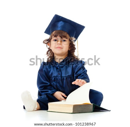 Little girl child in academician clothes  with book - stock photo